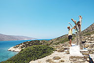 Greece, Nikouria, tourist looking to Amorgos in the distance - GEMF01014