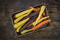 Three different sorts of carrots in a wooden box - LVF05301