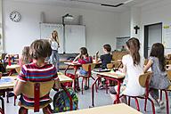 Woman teaching at class - SARF02880