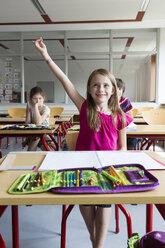 Portrait of smiling schoolgirl at class - SARF02901