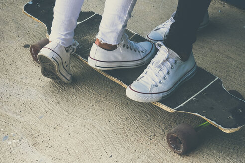 Feet of two teenagers on skateboard - SIPF00847