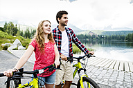 Young couple doing a bicycle trip - HAPF00840