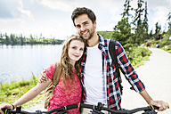 Young couple doing a bicycle trip - HAPF00852