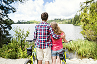 Young couple looking at view on a bicycle trip - HAPF00858