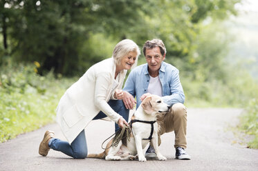 Senior couple with dog in nature - HAPF00873