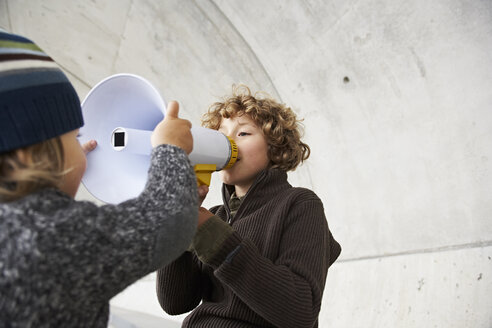 Two brothers playing with a megaphone - FSF00461