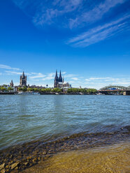 Germany, Cologne, view to the city with Cologne Cathedral and Rhine River in the foreground - KRPF01828