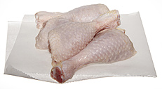 Raw chicken drums on wax paper - SCF00448