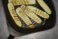 Fried zucchini slices in frying pan - SCF00460