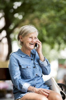 Portrait of laughing senior woman on the phone - HAPF00910