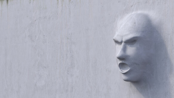 Displeased face growing out of concrete wall - AHUF00241
