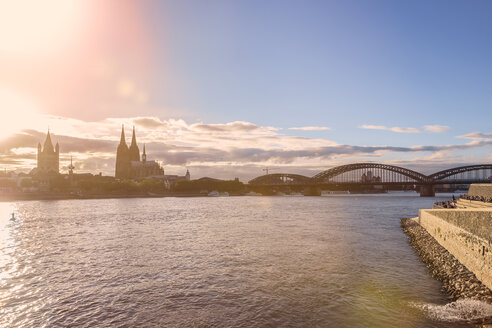 Germany, Cologne, view to the city with Rhine River in the foreground at evening twilight - KRPF01844