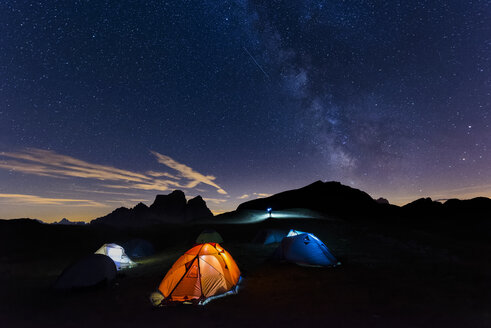 Italy, Dolomites, Milky Way over Monte Pelmo with tents of camp in the foreground - LOMF00399