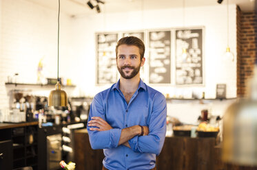 Confident young man in a cafe - DIGF01286