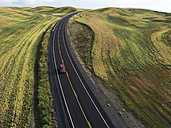 USA, Washington State, Palouse hills, road between fields - BCDF00020