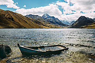 Peru, Huaraz, wooden boat sunk in a lagoon with Cordillera Blanca mountains in the background - GEMF01052