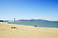 USA, California, San Francisco, Golden Gate Bridge and Fort Point as seen from Beach of Presidio - BRF01376