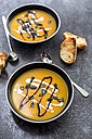 Creamed pumpkin soup in black bowl - SARF02916