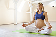 Prenatal yoga, woman meditating, lotus asana - ZEDF00335