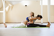 Prenatal yoga, female yoga instructor, stretching - ZEDF00344