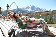 Family relaxing on panorama terrace in the mountains - FSF00506