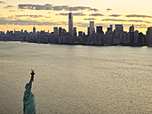 USA, New York City, Aerial photograph of the Statue of Liberty at sunrise - BCDF00039