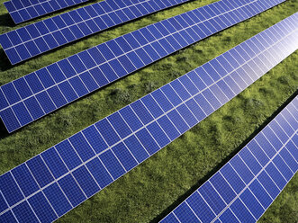 USA, North Carolina, Extreme low-level aerial photograph of solar panels in a solar farm - BCDF00084