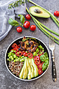 Fried chicken, quinoa, tomato, avocado, spring onion, rosemary and basil in bowl - SARF02925