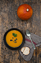 Organic pumpkin soup in black bowl - LVF05358