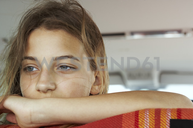 Portrait of serious teenage girl inside car - FSF00525