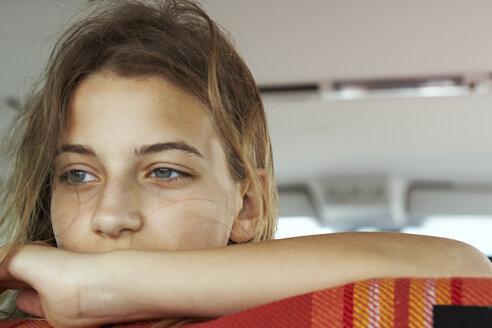Portrait of serious teenage girl inside car - FSF00525