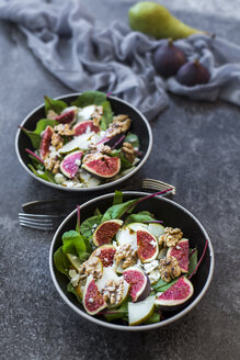 Bowls of baby chard salad with pear, figs, walnuts and feta - SARF02935