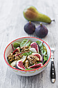 Bowl of baby chard salad with pear, figs, walnuts and feta - SARF02938