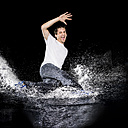 Man jumping in splashing water - STSF01100