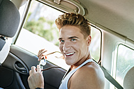 Happy young man in a car - KIJF00779