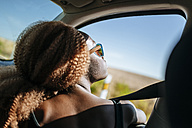 Young woman looking out of car window - KIJF00782