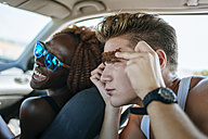 Young couple having fun inside a car - KIJF00788