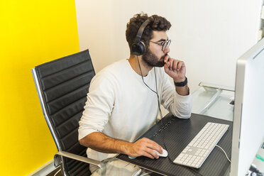 Young man working with computer in an office - TCF05118
