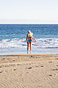 Spain, Tenerife, young female surfer on the beach - SIPF00874