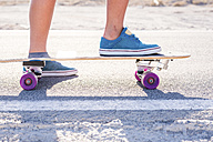 Spain, Tenerife, young skater standing on skateboard, blue shoes - SIPF00898