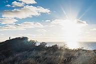 Denmark, North Jutland, person in dunes in backlight - MJF02049