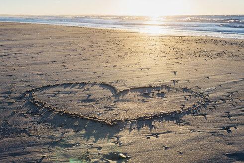 Denmark, Blokhus, heart drawn in sand on the beach - MJF02079