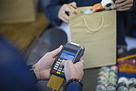 Salesperson using card reader for card payment - ZEF10467