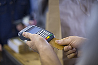 Salesperson using card reader for card payment - ZEF10473