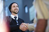 Two men shaking hands outdoors - ZEF10479