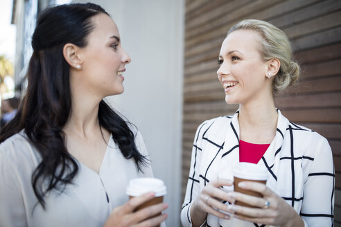 Two smiling women with takeaway coffee - ZEF10482