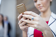 Close-up of woman holding cell phone - ZEF10488