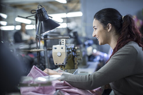 Seamstress in factory sewing clothes - ZEF10527