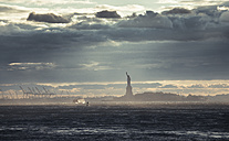 USA, New York City, Statue of Liberty at sunset - STCF00258
