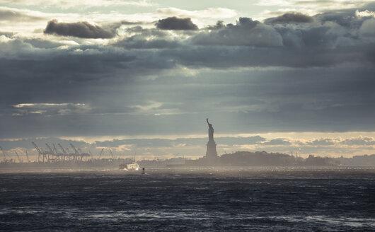 USA, New York City, Statue of Liberty at sunset - STCF00258